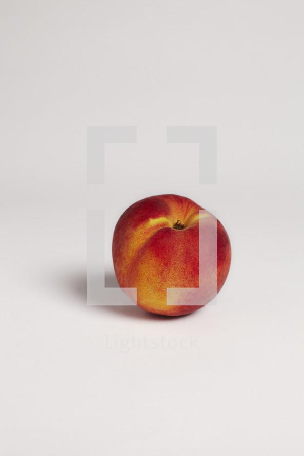 Single peach on seamless white