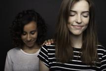 teen girls praying together