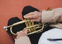 Veteran sitting holding a trumpet