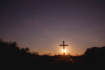 sunset behind a cross