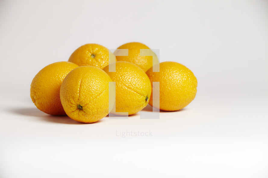 A cluster of oranges isolated on white