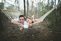 Couple on hammock in the forest