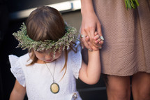 a flower girl and bridesmaid