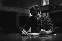 man writing in a notepad
