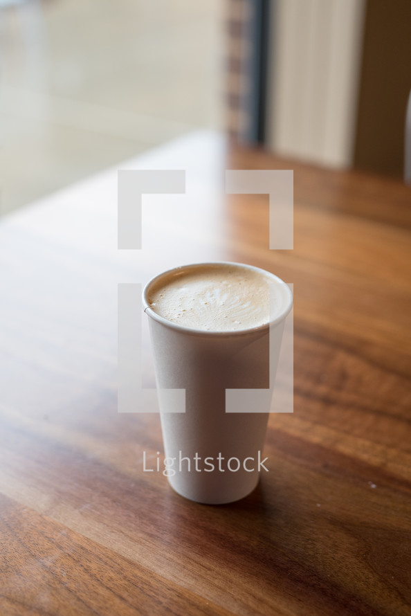 cup of coffee on a wood table