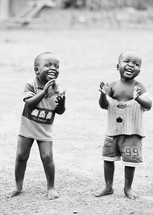 Toddler boys clapping in Sudan, Africa