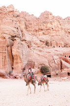 saddles on camels in the desert