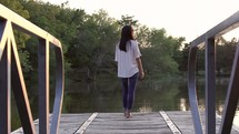 woman walking down a dock