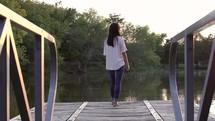 woman walking down a dock