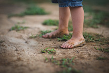 child's dirty bare feet