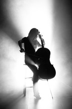 woman playing a cello on stage