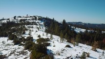Multiple shots of a mountain forest with snow - (Shoot 1 of 3)