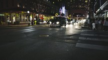 cars on a downtown street at night