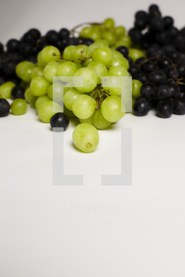 Bunches of green & purple grapes isolated on white