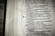 A closeup of the scripture Isaiah 9:6 in the Bible