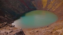 aerial view over a pond in a crater