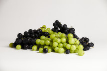 Mixed grapes isolated on white