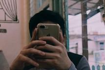 a man holding a cellphone