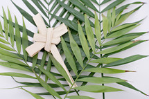 Palm fronds and cross