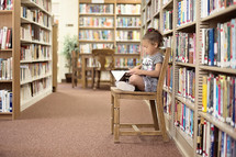 girl child reading in a library