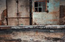 broken window and rusty door