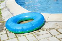 inner tube beside a pool