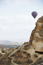 hot air balloons over desert canyons