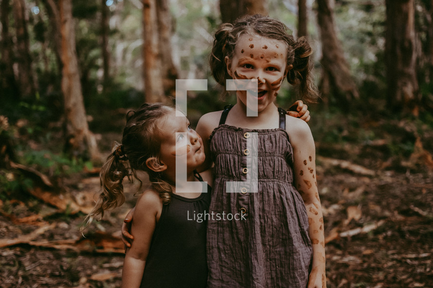 little girls with mud on their faces
