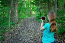a girl with a camera taking pictures
