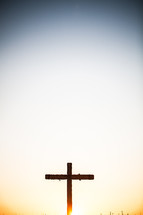 Cross on the hill at sunrise.