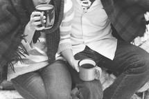 a couple sitting together drinking coffee