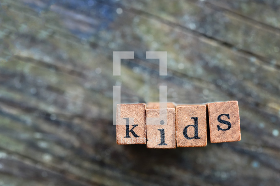 wood blocks with the word kids