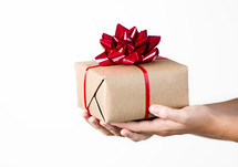 A person holding out a gift on a white background