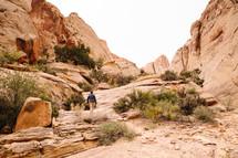 A hiker in a rocky landscape.