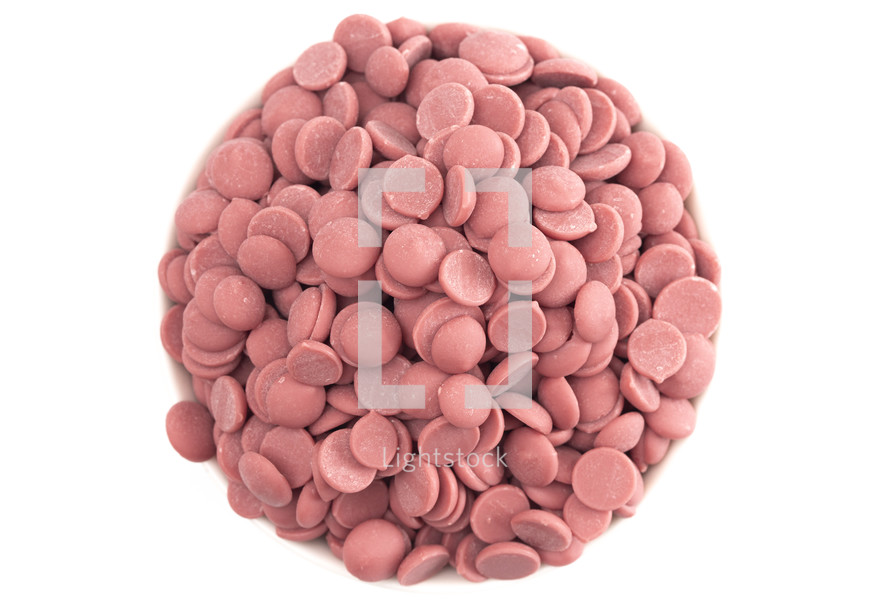 Authentic Ruby Chocolate Drops on a white Counter