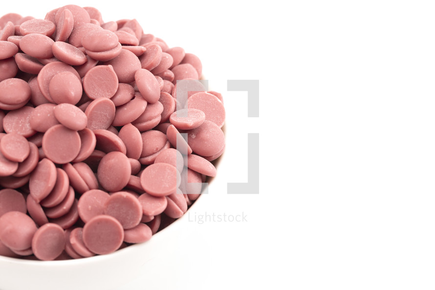 bowl of Authentic Ruby Chocolate Drops on a white Counter