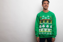 man in an ugly Christmas sweater and santa hat