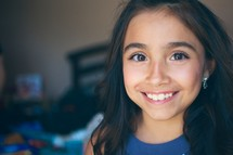 Face of a young girl smiling