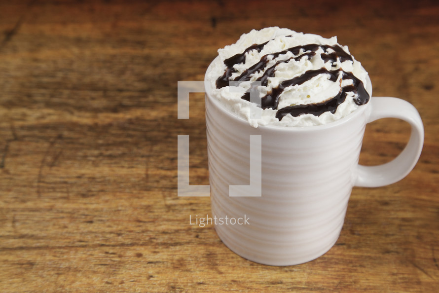 mug with whipped cream and chocolate syrup