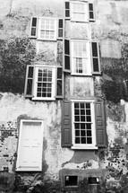 tall brick building, door, and exterior windows