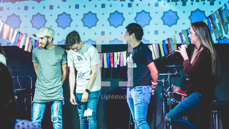 young people on stage answering questions during a worship service
