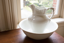 white pitcher and basin
