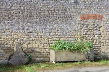 planter box in front of a stone wall