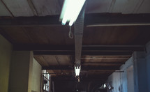 fluorescent lights hanging from a ceiling