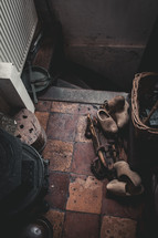 wooden clogs by a stairway