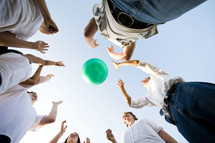 teens tossing a ball