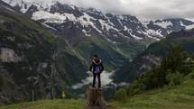 a man standing on a tree stump