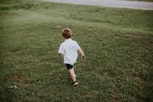 child running in grass