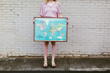 young woman holding a framed map