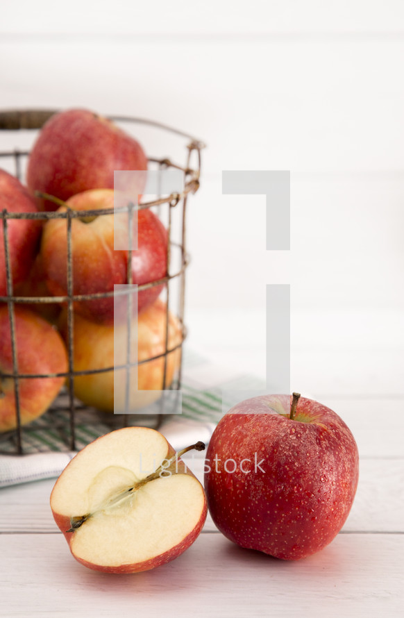 wire basket with apples